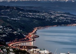 Aerial timelapse view of Wellington highways in evening.