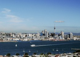view from the air of Auckland harbour with downtown skyline in background featuring sky tower